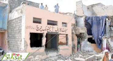 Locals watch in disbelief as a part of Gujjar Nullah's legendary St. Joseph's church is demolished